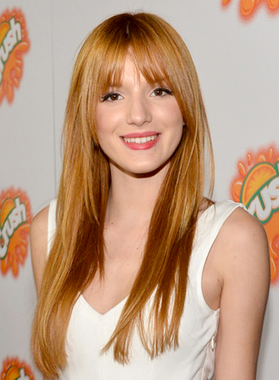 Bella Thorne's Long, Chic, Straight, Red, Hairstyle with Bangs