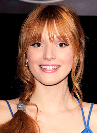 Bella Thorne's Long, Wavy, Red, Hairstyle with Braids and Twists and Bangs