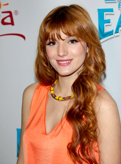 Bella Thorne's Red, Wavy, Romantic Hairstyle with Bangs