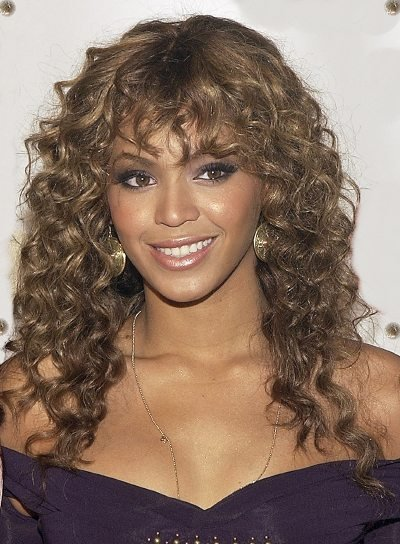 Beyonce Knowles Curly Hairstyle with Bangs