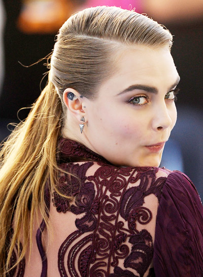 Cara Delevigne with a Long, Brunette, Straight, Ponytail Hairstyle