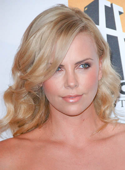 Charlize Theron's Medium, Wavy Hairstyle with Bangs
