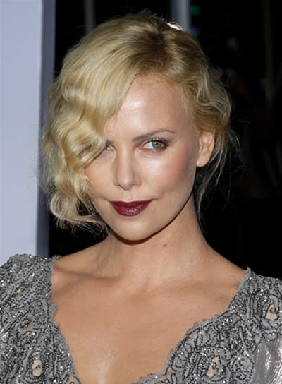 Charlize Theron's Romantic Updo with Bangs