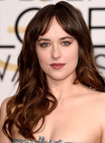Dakota Johnson with a Long, Tousled, Wavy Hairstyle with Bangs Pictures