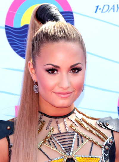 Demi Lovato's Long, Blonde, Funky, Ponytail Hairstyle