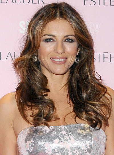 Elizabeth Hurley Long, Romantic, Wavy, Brunette Hairstyle with Highlights
