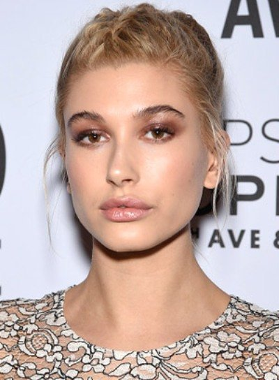 Hailey Baldwin with a Funky, Blonde, Updo Hairstyle with Braids and Twists Pictures