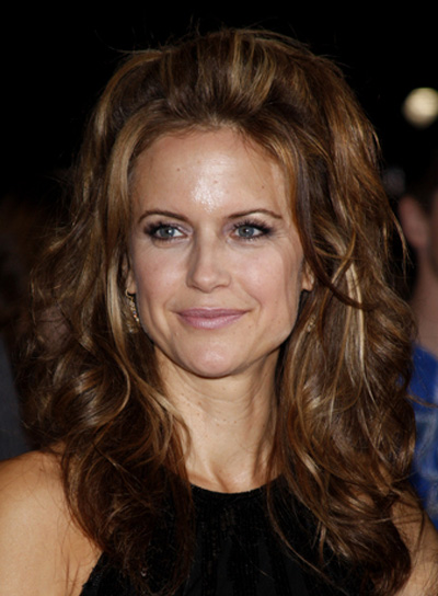 Kelly Preston Long, Curly, Sophisticated, Brunette Hairstyle with Highlights