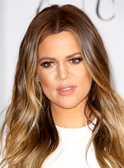 Khloe Kardashian with a Long, Brunette, Wavy, Hairstyle with Highlights