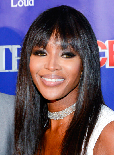 Naomi Campbell's Long, Straight, Black Hairstyle with Bangs