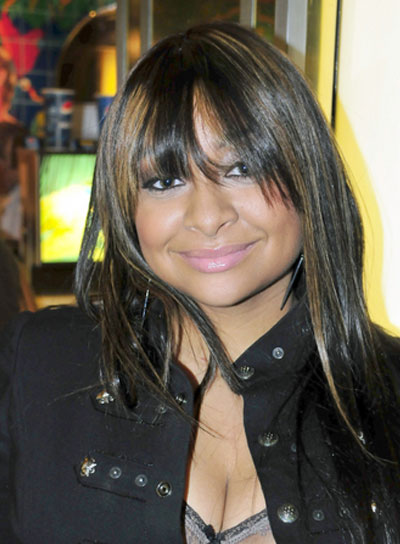 Raven Symone Long, Straight, Black Hairstyle with Highlights and Bangs