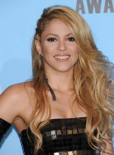 Shakira Long, Wavy, Tousled, Blonde Hairstyle