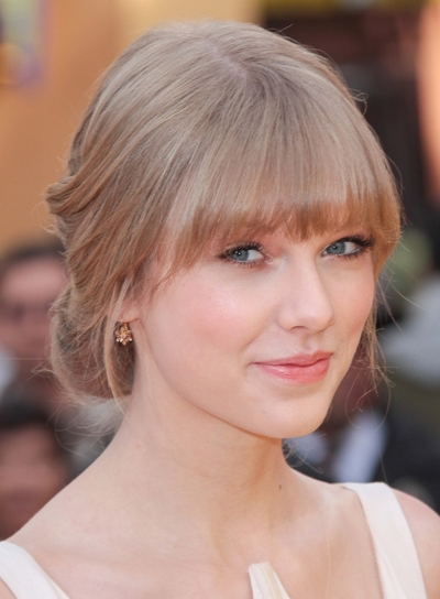Taylor Swift Romantic, Chic, Blonde Updo with Bangs