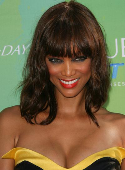 Tyra Banks Medium, Wavy, Brunette Hairstyle with Bangs